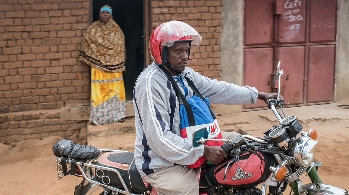 Rashidi Gora, a community health worker in Dodoma, Tanzania, leaves his house for another day hunting for tuberculosis cases.<br /><i>The Global Fund / Nichole Sobecki</i>