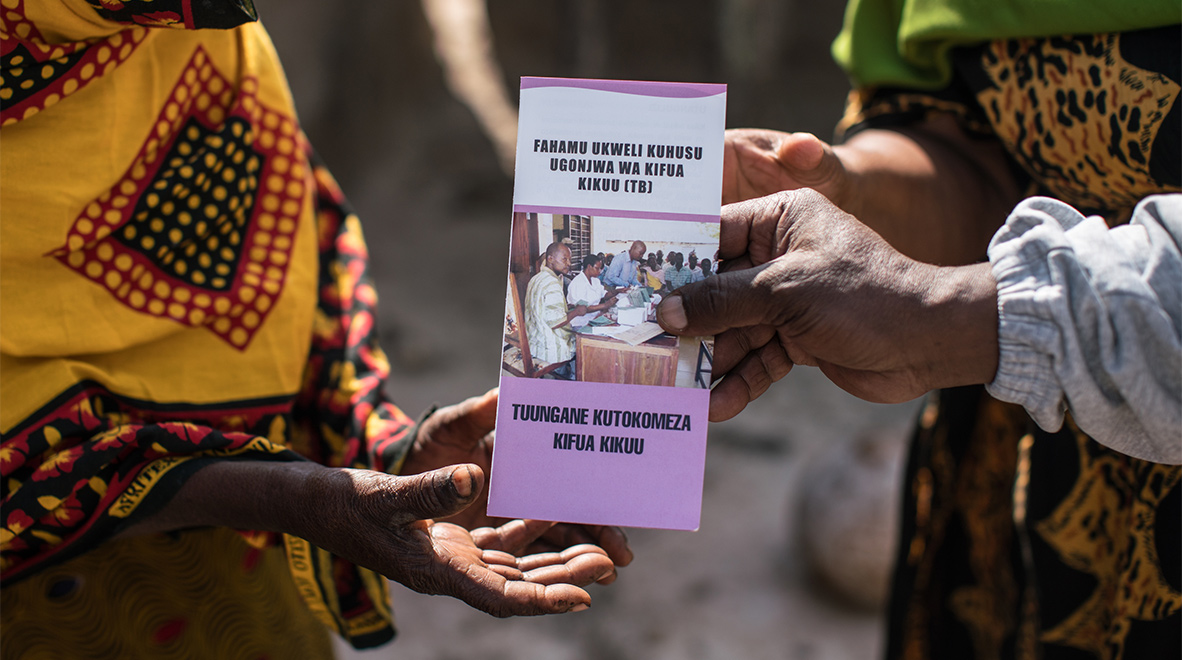 Gora also hands out flyers as part of an effort to educate villagers on how to prevent themselves from the disease.<br /><i>The Global Fund / Nichole Sobecki</i>