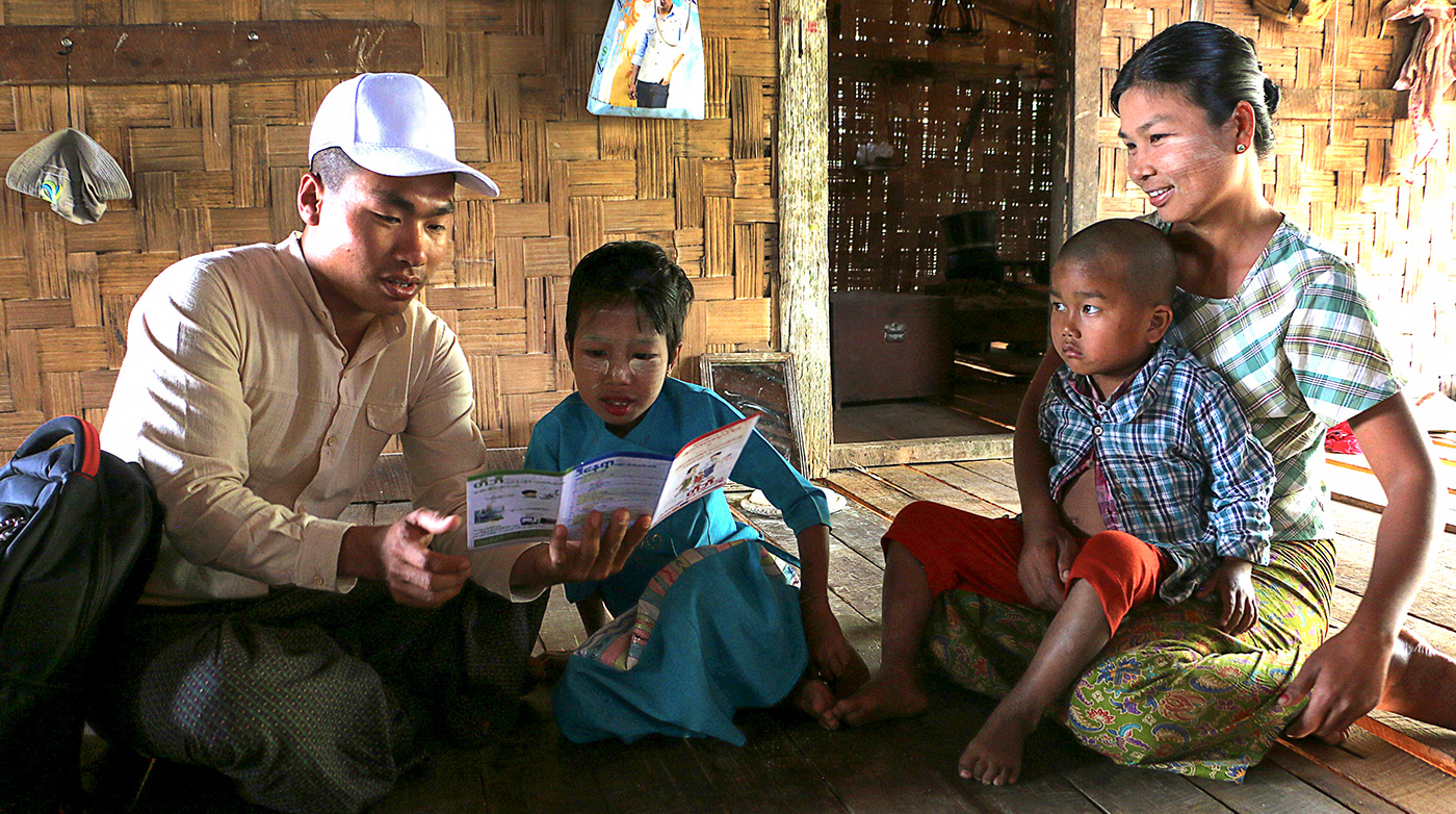 "<p>3<sup>rd</sup> PRIZE in the category IMPACT AGAINST AIDS, TUBERCULOSIS AND MALARIA, by Kyi Pyar Soe:</p> <p>In Myanmar, 24-year-old TB community health worker Yon Naing Oo (left) gives health education and counselling to TB patients, including those who are co-infected with HIV. He visits the home of Ma Khiin Son Oo and her two children, who are all living with HIV. 8-year-old May Thinzar Oo has also been diagnosed with TB.</p> <p>What the jury thought: <em>""Community health workers are highly trusted and respected members of the communities they serve, and Kyi Pyar has demonstrated it beautifully through this image.""</em></p>"