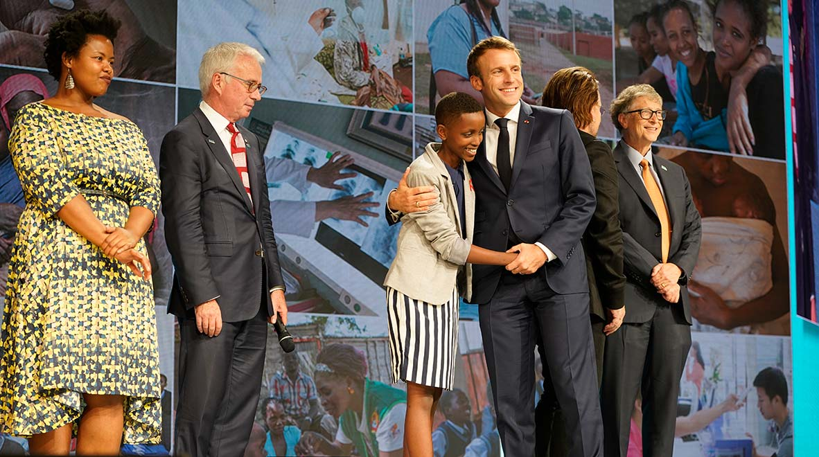 French President Emmanuel Macron embraces Amanda Dushime of Burundi, who lives with HIV, at the conclusion of the Global Fund's Sixth Replenishment Conference in Lyon, France 10 October 2019.
